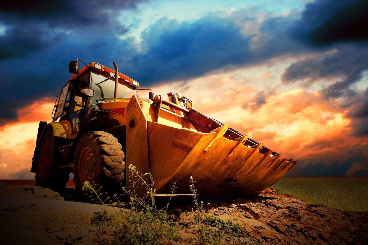 8255242 - yellow tractor on golden surise sky